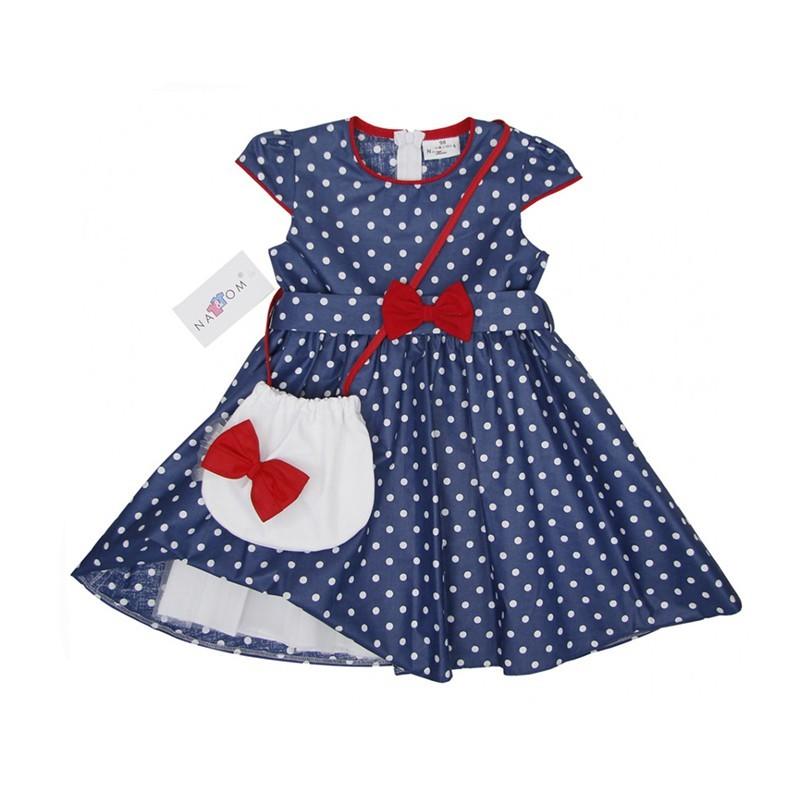 0d7909fd6a Kék alapon fehér pöttyös elegáns kislány ruha. Kiváló viselet minden ünnepi  alkalomra.